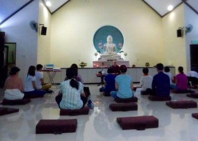 nun teaching people in temple