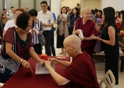 Donors sponsored 210 copies of Good Karma for free distribution. Ven. Chodron signs over 150 books in one day!