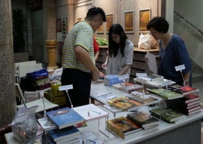 Man showing books and pamphlets to woman