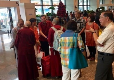A crowd sends our nuns off to India, where—among other activities—they will attend the ceremonies when His Holiness the Dalai Lama gives degree certification to the first 20 female geshes.