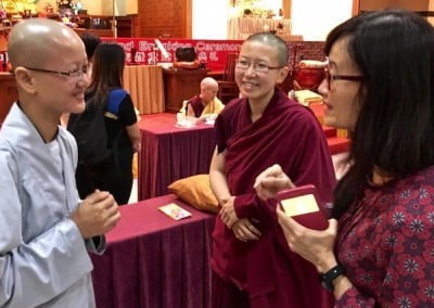 A nun from Vietnam attends the entire week of teachings. She chats with Ven. Damcho and core FOSA-S member Lay Ling.
