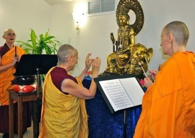Venerable Chodron makes an incense offering to all the Buddhas and bodhisattvas in the ten directions.