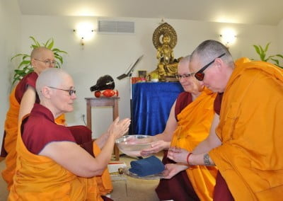 Venerable Chonyi washes her hands of all defilements as a symbol of her intention to work on her mind during Varsa.