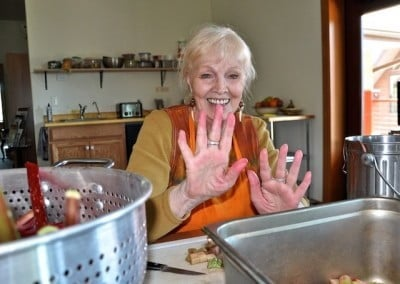 "Bon shows us her ""rhubarb hands"" as she prepares the fresh stalks harvested from the garden for the freezer."