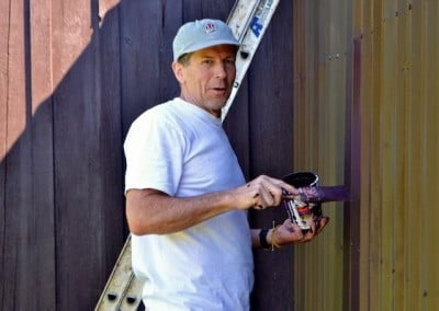 Doug helps with painting the dairy shed.