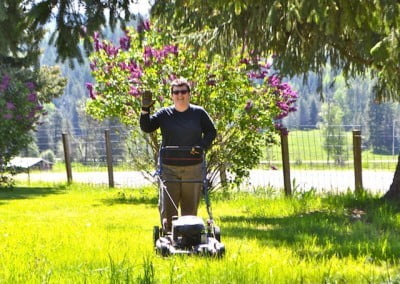 Michelle gives Tara's front yard a much needed mowing.