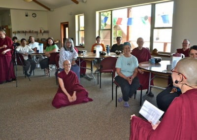 Venerable Damcho gives the daily Bodhisattva's Breakfast Corner talk before lunch.