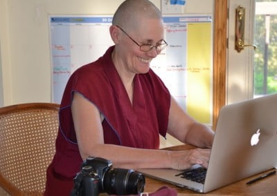 Venerable Chonyi is working on the Abbey's new website.