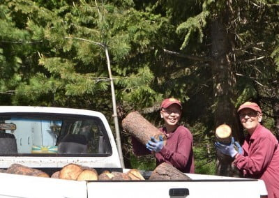 Venerables Semkye and Damcho load up the small truck with fresh firewood.