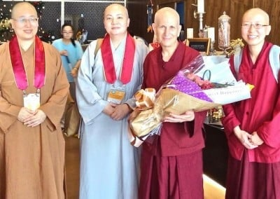 Ven. Tian Yue and Ven. Sheng Yuan from the CBBA reception team welcome Vens. Chodron and Damcho to Taiwan.
