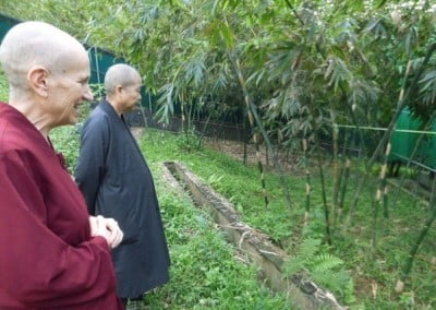 Ven. Chodron enjoys the beauty and the tour. with founding abbess Ven. Zhao Yin.
