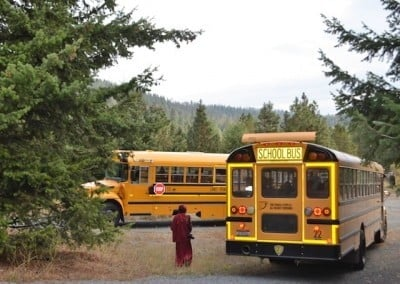 nun with two buses