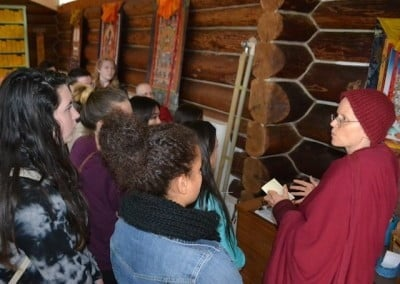 Ven. Tarpa gives the students a tour of the meditation hall.
