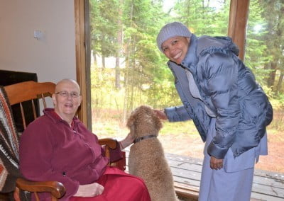 two nuns with dog