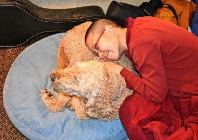 Nun hugging dog