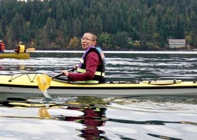 Nun kayaking on river