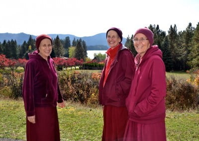 Three nuns standing outside