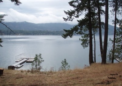 Hayden Lake is still and quiet under cloudy grey skies.
