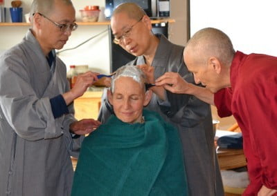 Ven. Tsepal undergoes the traditional head shaving.