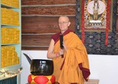Nun prepares to ring large gong