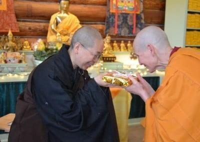Ven. Tsepal makes an offering to Ven. Jendy.