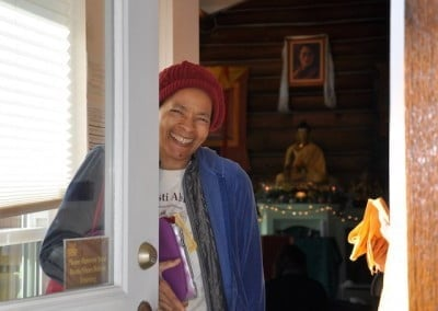 Cheryl greets us at the door of the Meditation Hall.