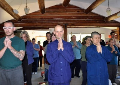 We all stand and prepare our minds for chanting.