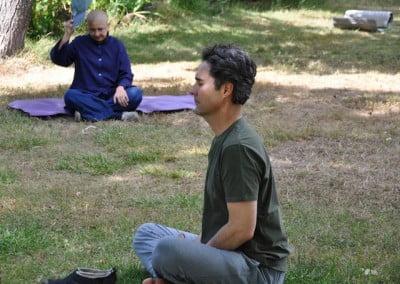 Tom settles into sitting meditation between the walking meditations.