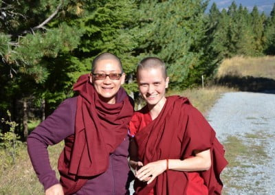 Buddhist nuns posing together outside