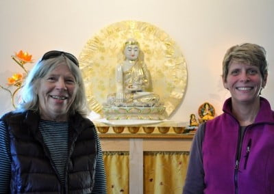 Mother and Daughter before Chinese Buddhist statue