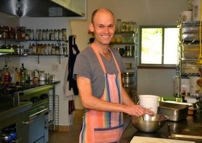 Anagarika Stephen cooking in abbey kitchen