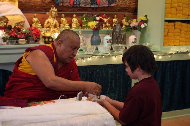 Guest teacher Khensur Wangdak Rinpoche offers a gift.
