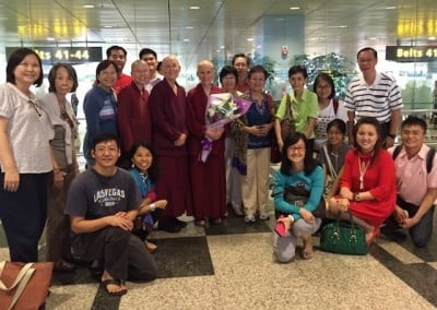 Group photo of Buddhist nuns and lay people