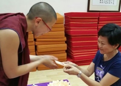 A Buddhist nun speaks with a young woman