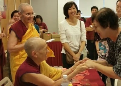 A Buddhist nun speaks to a lay person