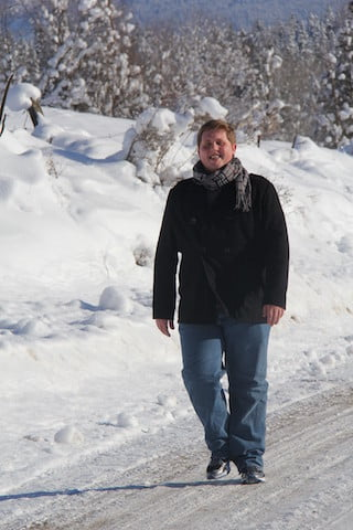 A man on a snow covered path