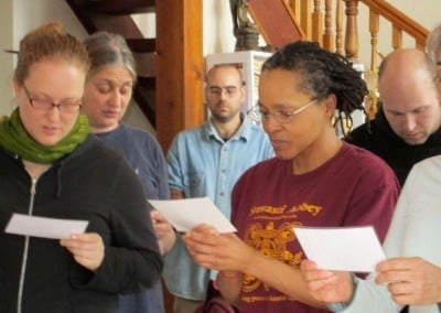 The retreatants join together to make the food offering prayer, formally offering their loads of vegetables, cheeses, and fruit to the sangha.