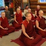 Monastics and lay people meditate
