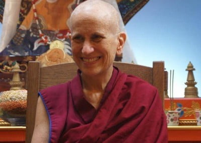 A close up of Venerable Chodron smiling happily.