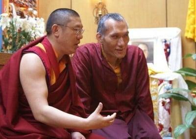 Yangsi Rinpoche and Khenpo Jampa Tenphel from Sakya Monastery in Seattle talking to each other.