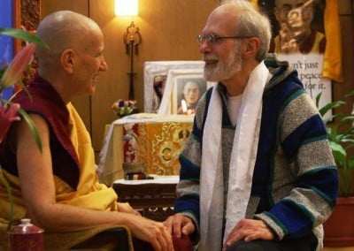 A man - Bob Wilson, a long time student and weekend host for the Abbey men, sitting and talking to Venerable Chodron.