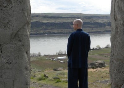 Ken standing with his back facing the camera, enjoying view of the river in front of him.