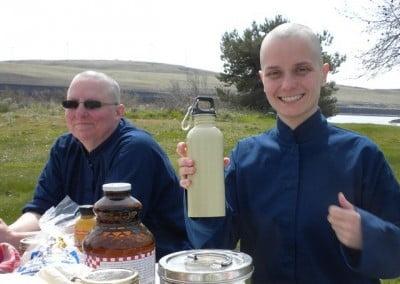 Terri and Dani smiling, Dani taking a bottle in her hand.