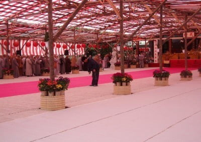 A big tentage with buddhist nuns and monks lining up.