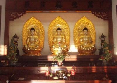 Three gold statues of Buddha - Amitabha Buddha, Sakayamuni Buddha and Medicine Buddha.