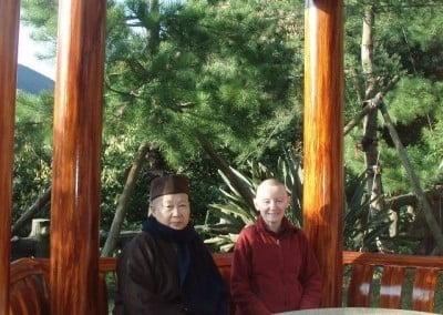 Venerable Samten sitting beside a chinese bhikshuni.
