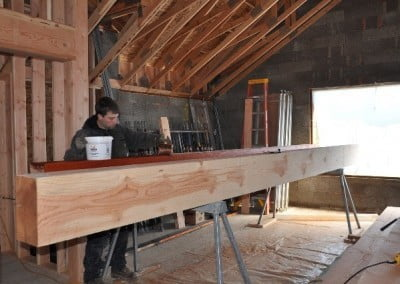 Alan stains the large Doug fir columns with a transparent stain that accentuates the grain.