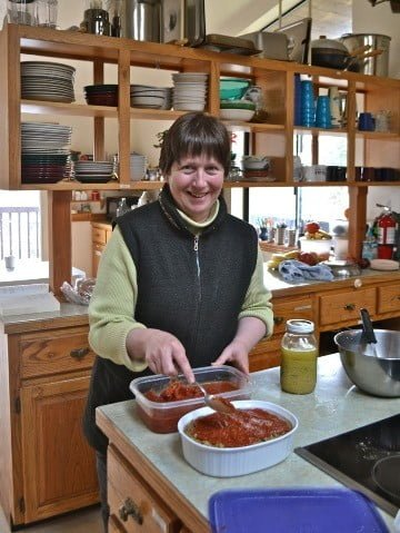 Tracy works her magic in the kitchen <br> as she offers a meal to the residents.