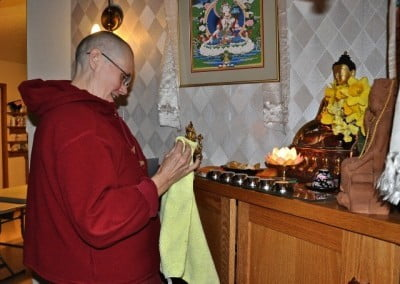 After a busy day in the Dharma, Venerable Chonyi spends some quiet time with the Buddha.