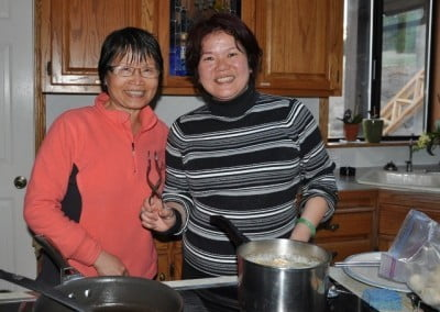 With a lot of joyous effort, Sue and Aster offer a delicious vegetarian Chinese feast for the Abbey community and guests.